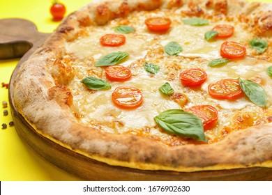 Delicious pizza Margherita on color background, closeup