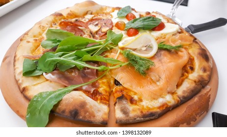 Delicious pizza served on wooden plate