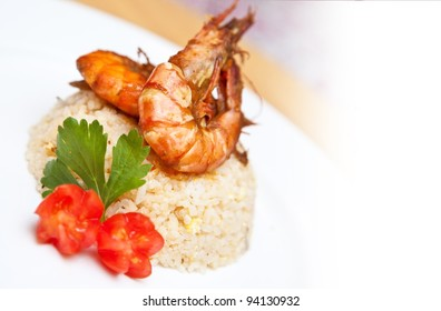 Delicious plate of Asian fried rice with tiger prawns