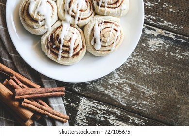Delicious plate of Cinnamon Rolls with cinnamon sticks