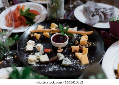 Delicious plate with different assortment of cheese and berry sauce, daily specials