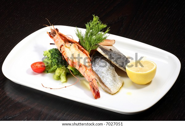 Delicious plate of prawns and fish fillet