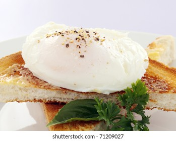 Delicious poached egg sprinkled with cracked pepper.