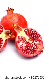 Delicious pomegranates with water drops