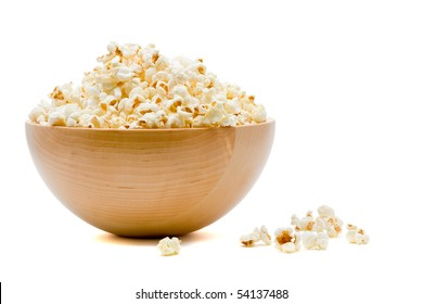 Delicious popcorn in bowl over white background