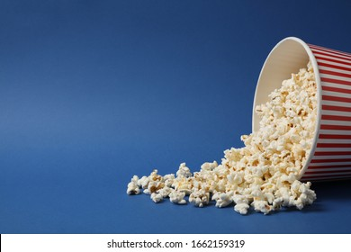 Delicious popcorn on blue background. Space for text