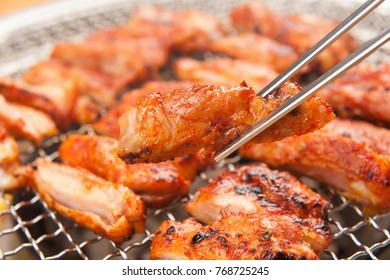 Delicious pork chops on a frying pan or grill
