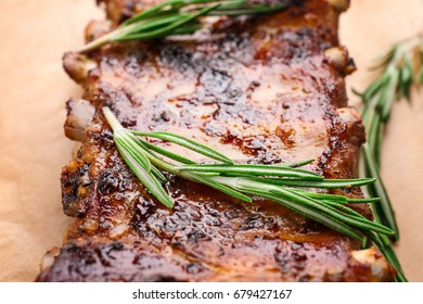 Delicious pork ribs with rosemary, closeup