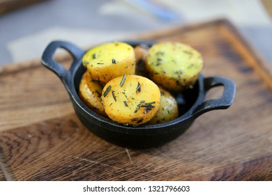 Delicious potatoes in the village with greens in iron utensils photographed close-up