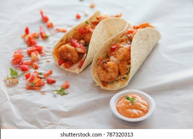 Delicious prawn tacos for two with condiments and dip sauce chipotle