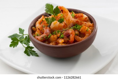 delicious prawns cakein in clay dish