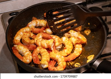 Delicious prepared shrimps in the fry pan. Roasted shrimps with  herbs. Seafood, shellfish. Shrimps Prawns grilled with spices on cast iron pan
