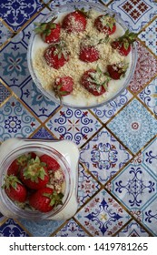 The delicious puding with strawberries
