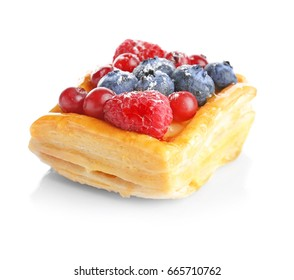 Delicious puff pastry with berries on white background