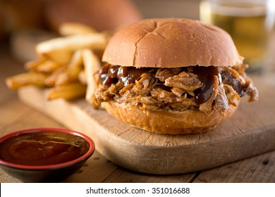 A delicious pulled pork sandwich with barbecue sauce on a bun.