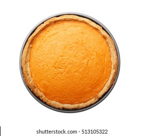 Delicious pumpkin cake in baking dish on white background