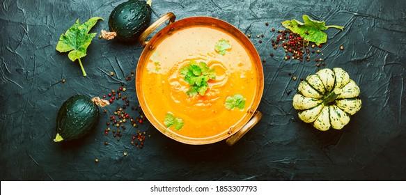 Delicious pumpkin soup and autumn pumpkins.Seasonal autumn food