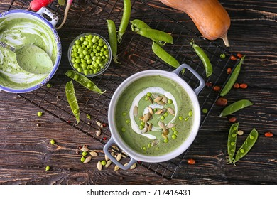 Delicious puree from green peas in casserole on wooden background
