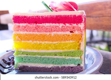 Delicious rainbow cake on plate