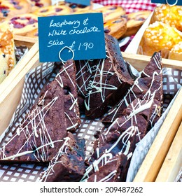 Delicious raspberry and chocolate cake slices in British market