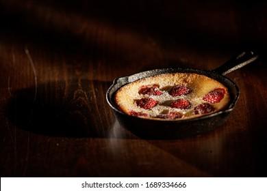 Delicious Raspberry pancake in cast iron pan