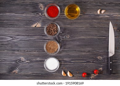 A delicious recipe frame on a dark textured oak table with spices a meat cleaver and olive oil