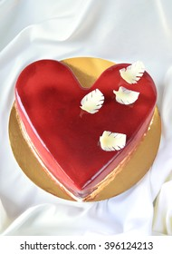 Delicious red cake decorated with white chocolate feathers
