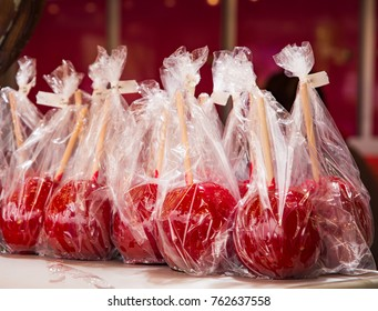 Delicious red candy apples in plastic foil