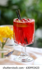 Delicious red cocktail in glass with drinking straw to take pictures of closeup