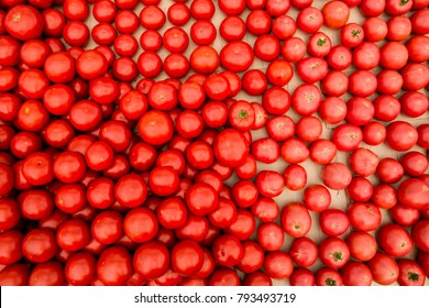 Delicious red tomatoes. A pile of tomatoes