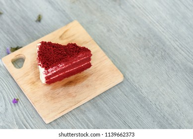Delicious Red velvet slice cake on wood board, selective focus