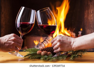 delicious red wine at romantic fireplace