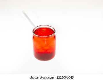 Delicious refreshing colorful beverage with straw isolated against white background.