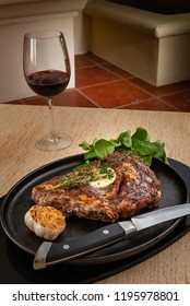 Delicious Rib Eye Steak with Roasted Garlic with a glass of wine