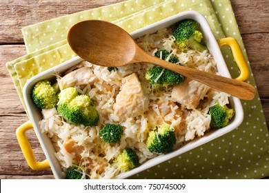 Delicious rice with broccoli, chicken and cheese close-up in a baking dish on a table. horizontal top view from above