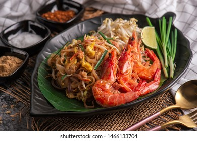 Delicious rice noodles with shrimp and vegetables close-up
