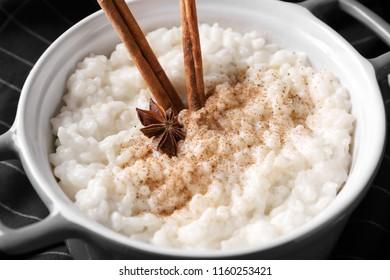 Delicious rice pudding with cinnamon and anise in casserole, closeup