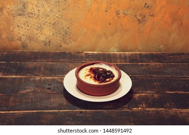 Delicious rice pudding on wood rustic background