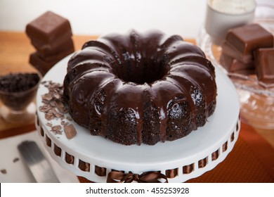 Delicious rich sweet chocolate bundt cake whole complete on a stand