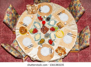 Delicious rich Traditional Turkish breakfast include tomatoes, cucumbers, cheese, eggs, honey, bread, bagels, olives and tea cups. Ramadan Suhoor aka Sahur (morning meal before fasting). Top view