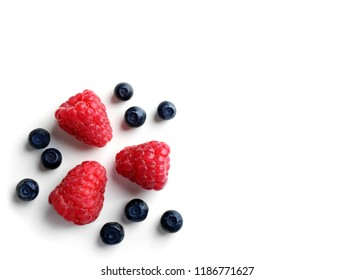 Delicious ripe berries on white background, top view
