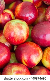 Delicious ripe fruit nectarine in the market on the counter