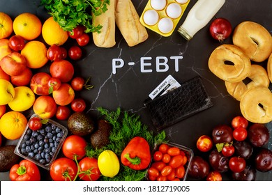 Delicious ripe fruits with vegetables on black background and text p-ebt.