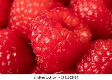 Delicious ripe red raspberries. Juicy raspberries.
