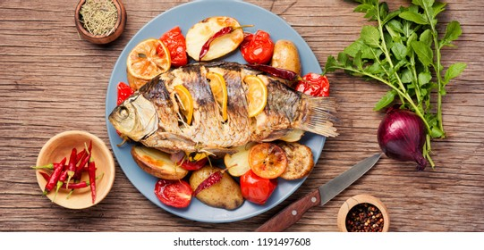 Delicious roasted fish with lemon and garnish.Diet and healthy food