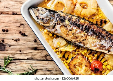 Delicious roasted fish with pineapple.Fishes baked in baking dish