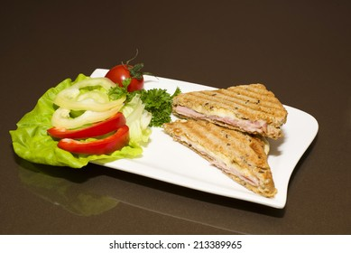 Delicious roasted sandwich with vegetables on a plate offering.