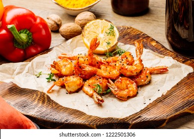Delicious roasted shrimps on plate with  lemon
