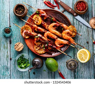 Delicious roasted shrimps on skewers with lemon.BBQ shrimp grilled.Cooking seafood