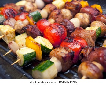 Delicious roasted skewers made of meat and vegetables